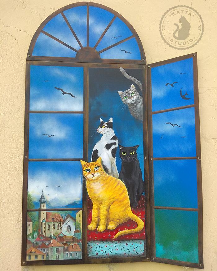 Torba na urlop i koty w oknie